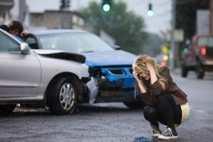 Young woman involved in road accident --- Image by © Image Source/Corbis